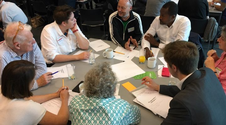 people round table at community-led housing hub launch